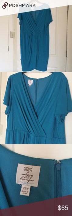 Stylish teal cocktail dress Flattering, knee length cocktail dress with front faux wrap detailing. Fluttery butterfly short sleeves. This dress looks great on!  Excellent condition, worn once. From Nordstrom's, by Suze Chin for Maggy Boutique. Suze Chin Dresses