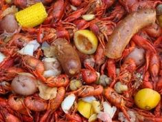 New Orleans Crawfish Boil.  This is amazing!!  When I do the boil like this I actually omit the potatoes, no one eats them.  But I do make a great chopped salad with a vinaigrette dressing and something rich for dessert served in smaller portions.