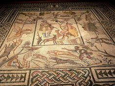 A fourth century floor from the Roman Empire, found in France, featuring mosaic pebble tiles depicting several deities with Diana and Calistos featured in the center