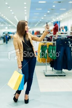 Young woman with shopping bags and mobile phone Royalty Free Stock Photo