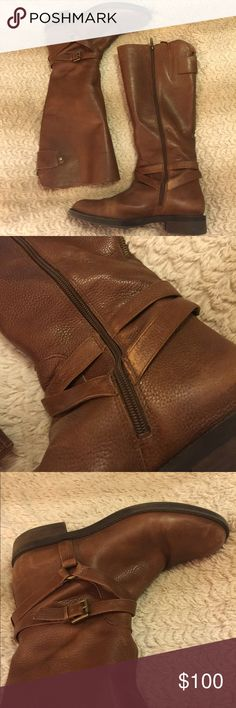 Leather Riding Boots Gently worn.                                          Zipper closure. Rounded-toe silhouette. Buckled ankle strap. Synthetic lining and footbed. Wrapped heel. Synthetic outsole. Enzo Angiolini Shoes Combat & Moto Boots