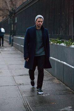 Shop this look on Lookastic:  https://lookastic.com/men/looks/overcoat-crew-neck-sweater-skinny-jeans-slip-on-sneakers-beanie/12602  — Grey Beanie  — Dark Green Crew-neck Sweater  — Navy Overcoat  — Black Skinny Jeans  — Black Leather Slip-on Sneakers