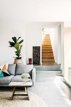 Trend Alert: Polished Concrete Floors via @MyDomaine...Shades of textural neutrals off the polished concrete floor in this room create a soothing vibe with happy, just-right pops of color. As the sunshine creeps in, it's almost as if the concrete is cooling the room off.