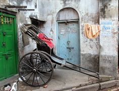 [General background: Meidun, travel] The Resting Rickshaw. Calcutta, West Bengal, India.