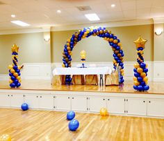 Blue & Gold balloon arch and colns