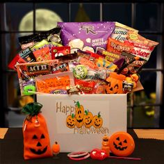 The Halloween Sampler Care Package Sweeten up your Halloween with this fun and affordable gift! It's a cute jack o'lantern decorated gift box filled with fun Halloween treats. Little monsters will just eat this up! Halloween Gift Baskets, Fun Halloween Treats, Halloween Jack, Halloween Cookies, Halloween Candy, Halloween Gifts, Happy Halloween, Halloween Table, Halloween Projects