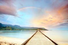 Hanalei Bay beach pier at sunrise with rainbow Kauai, HI