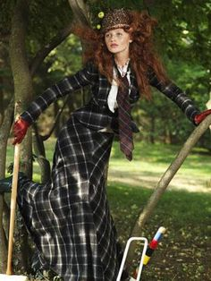 RULE 11: Take the skirt suit to the max in black plaid.Jacket, $2998, skirt, $3998, Ralph Lauren Collection; top, $48, Gap; boots, $375, Cole Haan; hat, $345, Kokin; tie, $45, Tommy Hilfiger; gloves, $300, Carolina Amato.