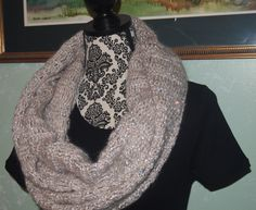 A personal favorite from my Etsy shop https://www.etsy.com/listing/479431003/grey-with-silver-sequins-infinity-scarf