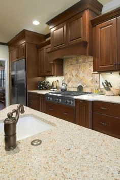 Cherry kitchen cabinets and traditional crown molding bring this kitchen a traditional touch.