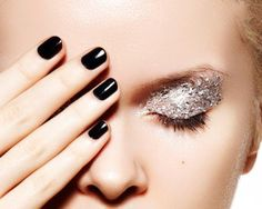 Glittered Makeup: Glitter Silver Eyeshadow & Black Nail Enamel.