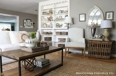 neutral living room, hardwood floors, white upholstery, living room built ins, gray walls