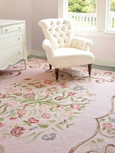 EYE-CATCHER ~~ Stunning floral, scrollwork rug in bright pink.  Rest of decor in neutrals and white is perfect frame.