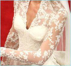 A close up of Kate's wedding lace bodice