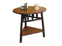 """www.foothillsamishfurniture.com -- Round End Table -- Why not """"mix it up"""" a bit? Combine a round top with a triangular shelf….you get a unique, outstanding End Table. Measurements: 27"""" Round x 24""""H Description: Hickory Logs, Oak Wood Top and Shelf with Michaels Stain -- Do you like the combination of a round table top and a triangular shelf? Repin if so!"""