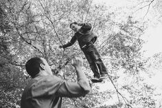A photojournalistic photograph of a father throwing his son in air during their lifestyle family photo session at the Arnold Arboretum in Boston, Massachusetts - Gina Brocker Photography