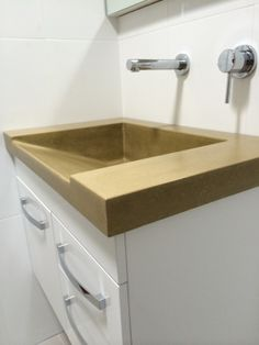 Custom Polished Concrete Vanity top with ramp sink. A big statement for an all-white bathroom. www.mbconcretedesign.com.au