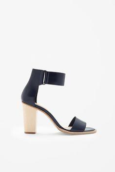 Strap heel sandals.   See more on shopstyle.com