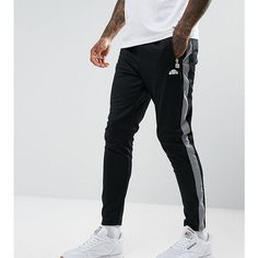 Ellesse Joggers With Reflective Panel ($44) ❤ liked on Polyvore featuring men's fashion, men's clothing, men's activewear, men's activewear pants, black and ellesse
