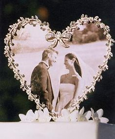 Our Heart Frame with Swarovski Crystals will look beautiful atop your cake and will be a wonderful remembrance of your party for years to come.