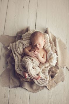 "Neutral colors keep the focus on the baby and create a ""soft"" look. 