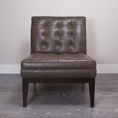 "Jagger Chair -Tufted leather slipper chair with contrasting, exposed wood frame. Tapered wood leg. Custom upholstery options available in store.             $3445.00    Style: 7751    Size: 16"" Seat height, 24"" W, 30""H Back, 21.5"" Seat depth  Overall depth 27.5""    Color: Patina Gray Leather             	                                      $3445.00             Style: 7751          Size: 16"" Seat height, 24"" W, 30""H Back, 21.5"" Seat depth          Color: Patina Gray Leather"