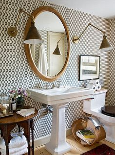 great wallpapered bathroom and the light fixtures.