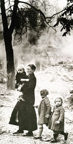 A family wanders homeless after a German air raid over Belgium.