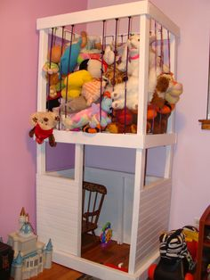 Get those stuffed animals out of the way, plus a place to play! DIY stuffed animal storage and playhouse
