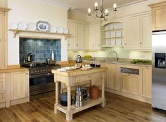 Love this timeless shaker kitchen, the stainless steel L Line range cooker looks great against the tiled splashback.