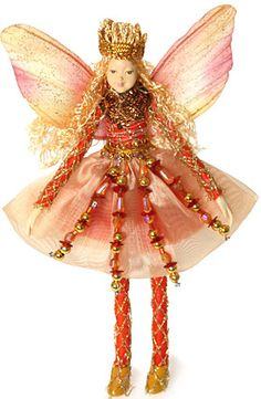Bendable Petal Fairies Peach Jewel Fairy Queen.  Petal Fairies are the most versatile fairies of them all. You can bend them to any pose. Dimensions:   Material: Head and Hands - Plastic Body - Co-Polyester Wings - Mesh with Wire for shaping Clothing - Nylon Price: $16.95