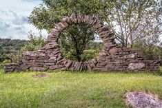 """""""The beautiful thing for me about dry stone masonry, and my life's work, is if you want to change it you just change it,"""" Ms. Alvin said. """"There's nothing permanent about this at all. Garden Paths, Garden Art, Compound Wall, Moon Gate, Stone Masonry, Dry Stone, Outdoor Rooms, Ny Times, Greenery"""
