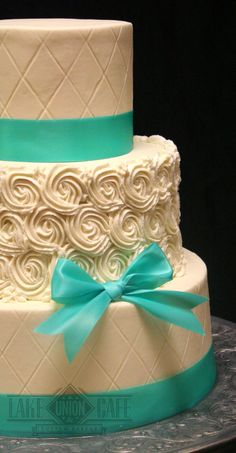 All buttercream wedding cake, quilting with rose swirls and tiffany blue ribbon.
