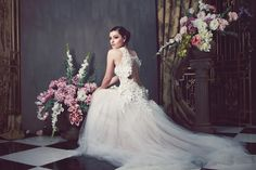 ANNA GEORGINA WEDDING DRESS COLLECTION 2014. Flowers and crystals bedeck this appliquéd open-back bodice atop a skirt of tulle.
