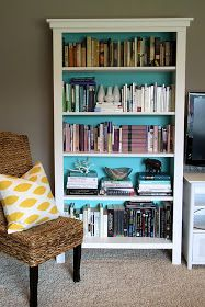 It might be cool to do a bookshelf with a beachy-colored background and ocean-related decorations throughout.