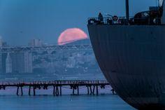 Moonset behind San Francisco - Bay Bridge, Ferry Building Moon Museum, Uss Hornet, Orange Moon, Moon Setting, San Francisco Skyline, Bella, Bridge, Around The Worlds, Ship