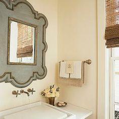 My Home Ideas - bathrooms - cream walls, cream bathroom walls, gray mirror, gold leaf trim mirror, gray and gold mirror, floating sink, floa...