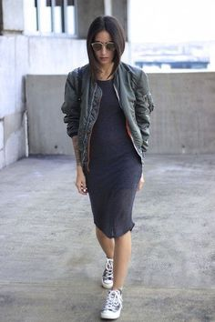 Try pairing a dark green bomber jacket with dark grey bodycon dress for a refined yet off-duty ensemble. For footwear go down the casual route with monochrome canvas high top sneakers.   Shop this look on Lookastic: https://lookastic.com/women/looks/dark-green-bomber-jacket-charcoal-bodycon-dress-black-and-white-canvas-high-top-sneakers/18266   — Dark Green Bomber Jacket  — Charcoal Bodycon Dress  — Black and White Canvas High Top Sneakers