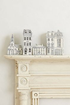 Molly Hatch Basilica Ornament #anthropologie ............ ceramic houses went on sale because they're 'ornaments' ... I snatched up the short one on sale, and I'd love to find the larger row houses