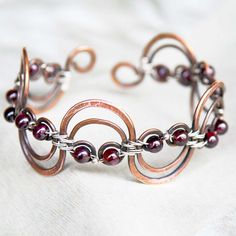 copper and sterling wave bracelet with garnet by nerolihandmade on etsy