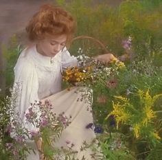 Anne picking flowers
