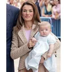 Crown Princess Letizia—also known as Letizia, Princess of Asturias—of Spain holds her daughter, Princess Leonor, at an Easter service at Palma Cathedral on 6 April 2006 (she gave birth to a second daughter, Sofía, in 2007).