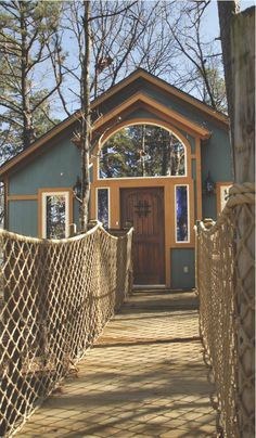 At The Grand Treehouse Resort in Eureka Springs, Arkansas, you can choose from a variety of vacation lodgings such as bungalows and treehouses in different architectural styles and constructed out of natural materials such as pine and cedar.