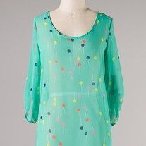 $25.00      Quarter sleeve top with lollipops printed all over  100% Polyester  Made In:	USA