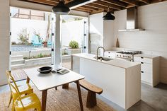 Architect Karen Curtiss of Red Dot Studio transformed a one-bedroom into a three-bedroom without increasing space.