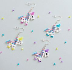 Bubblegum Unicorn Hama Bead Earrings is part of Unicorn crafts Colour Perler beads and silverplated earring hooks, with a rubber stopper on the back Both sides have been ironed for strength Colou - Perler Bead Designs, Hama Beads Design, Hama Beads Patterns, Beading Patterns, Mini Hama Beads, Diy Perler Beads, Perler Bead Art, Fuse Beads, Hama Beads Kawaii
