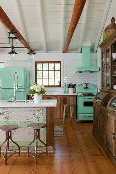Retro kitchen design. Beautiful combination of mint fridge, mint oven and wood furniture