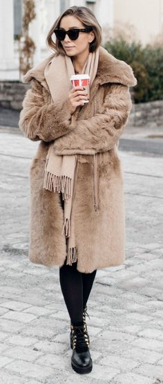 Nothing screams winter chic more + faux fur coat + Emilie Tømmerberg + looks a dream + gorgeous camel piece + chunky black laced boots and tights + edgy take on a classic look  Brands not specified.