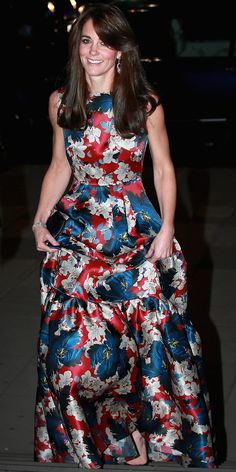 OCTOBER 27, 2015  For the 100 Women in Hedge Funds black tie dinner at the Victoria & Albert Museum in London, Middleton donned a head-turning Erdem gown with an eye-catching blue and red floral pattern. She teamed the dress with a black clutch, black shoes, and diamond-and-sapphire chandelier earrings.