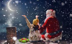 Обои Санта Клаус и девочка сидят на крыше дома под падающим снегом